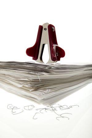 office stapler: Stapel puller on a sheaf of paper.