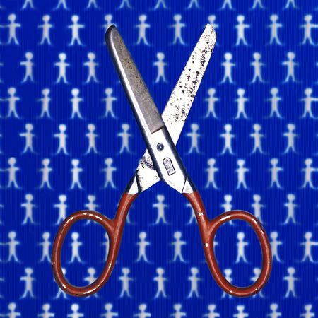 Antique saftey scissors floating over a background of paper dolls. The dolls arent a small as they look, I shrunk em.