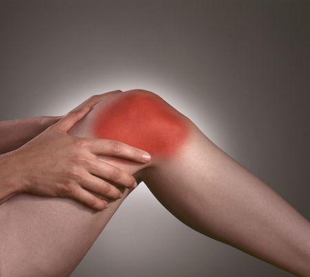arthritis knee: Arthritis pain in the knee joints, hands rubbing the pain.