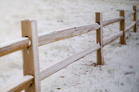 New cedar split rail fence, shot on a winter morning, under a sunless sky. photo