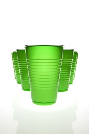 Empty plastic cups with mirrored reflection. Stock Photo