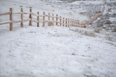 New cedar split rail fence, shot on a winter morning, under a sunless sky.