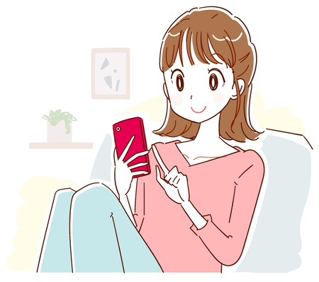 Young woman relaxing indoors while using a smartphone