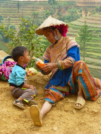 caring for: Vietnamese woman caring for her son Editorial