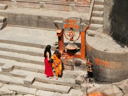 Women in the ghats of Pashupatinath in Nepal Stock Photo