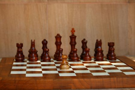gamesmanship: Wooden chess pieces on wooden board too Stock Photo