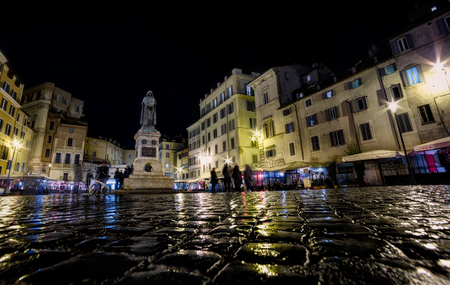 Statue of Giordano Bruno at Campo de Fiori square at night Editorial