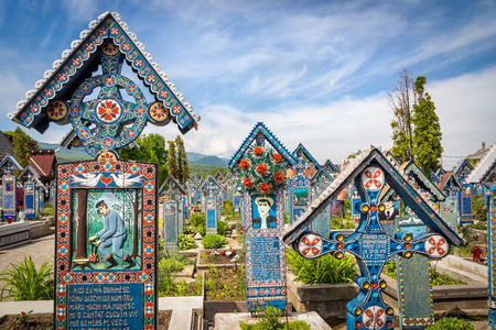 tombstones: Merry Cemetery in Sapanta, Maramures, Romania. Colorful tombstones with handicraft folk art are characteristic for this burial place.