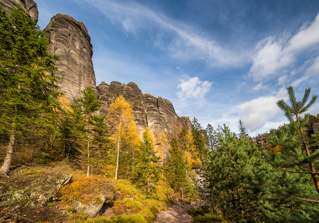 Colorful, autumn mountain valley in czech national park - Slalni Mesto. Steep mountains grow out from beautiful, yellow, gold, red and green fall forest Reklamní fotografie