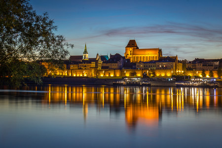 Panorama view of medieval city of Torun, Poland. Old town reflects in Vistula river. Stock Photo