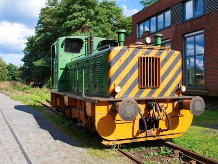 Old diesel locomotive on the siding photo