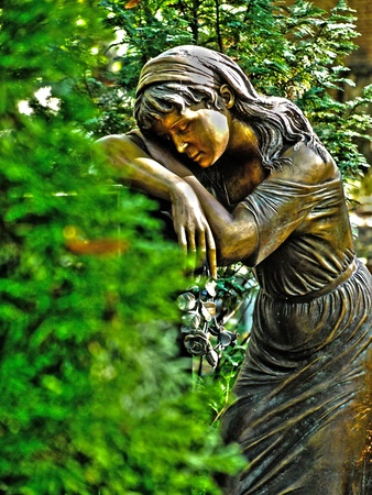 devotions: sleeping female statue in the cemetery