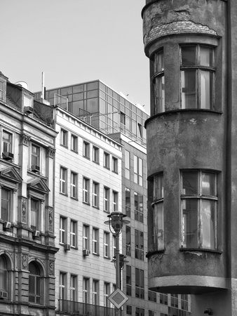 old and new architecture in a Berlin street, monochromatic absorption photo