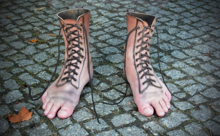 photomontage: surreal photomontage of shoe and foot