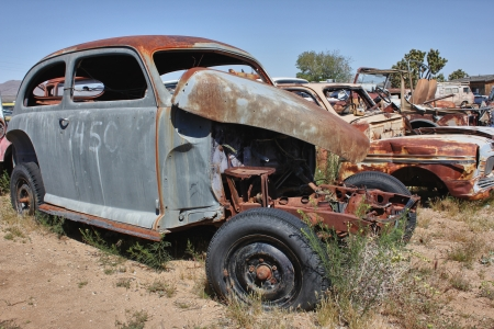 rusty car: old rusted car without an engine in a junkyard