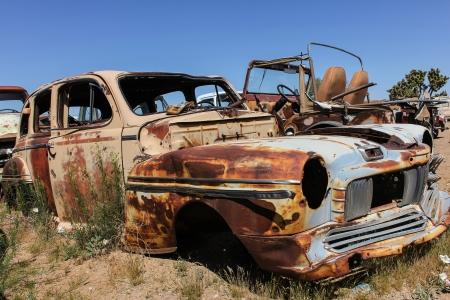 rusty car: old american car in a junkyard