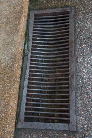 manhole: dirty iron manhole on street Stock Photo