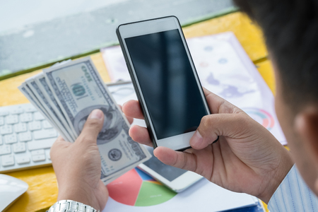 business pay bills with smartphone Stock Photo