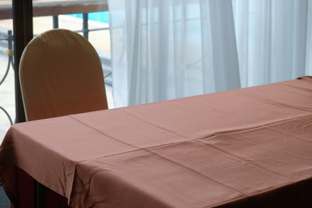 Brown tablecloth Near the chair In rooms with white curtains. Pool view