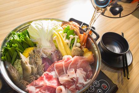 shabu-shabu food on wood background Stockfoto