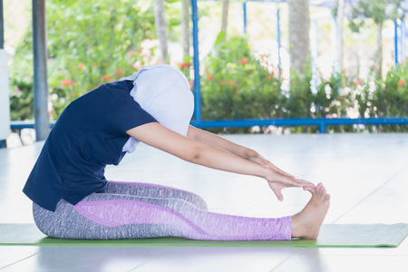 Asian young muslim yoga experts women are showing the correct posture for those attending yoga classes. Have followed