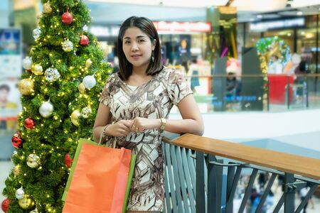 Asian woman walking and shopping in the mall