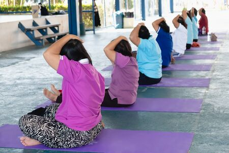 Posture of exercise with yoga There are participants of all ages, both young and old.  写真素材