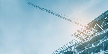 Construction site, cranes and scaffolding , concrete structure