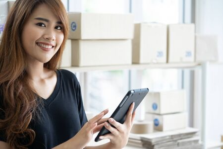 Asian women, business owners, sme are checking the order information.Business owners are proud of their business success.Business owners are happy with the success of ordering products.