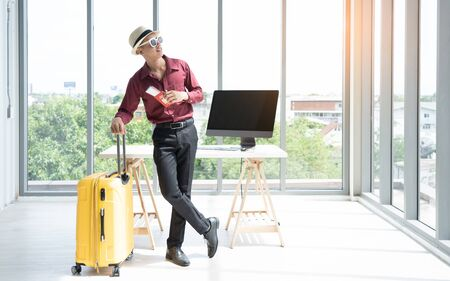Company employees prepare for weekend travel.Young asian businessman preparing for vacation in the office.