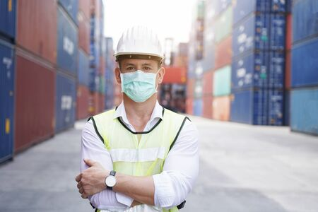 new normal concept,Portrait of the inspecting engineer Wear mask and helmet for safety while working in factory or warehouse background.Prevent accident from work or dust and Coronavirus. Stockfoto