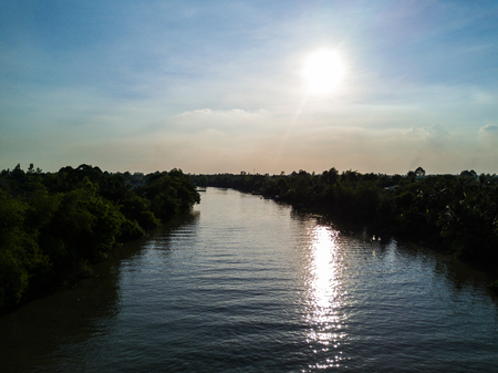 The river is quiet peaceful in the sunny day, in Vietnam. Taking with drone.