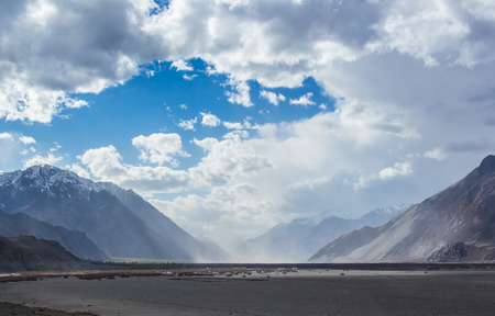 The sand storm between the huge snow mountains at Nubra Valley, Leh Ladakh.