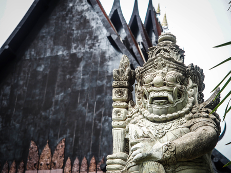 gaurd: Chaingrai, Thailand - May 31, 2015 : The sculpture of giant gaurd protecting the black house of the famous artist in Thailand, Tawan Dutchanee.