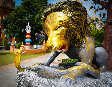 Chiangrai, Thailand - May 29, 2015 : The sculpture of lion catching snake in Sai Khao temple Editorial