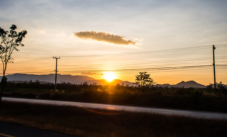 begin: The last moment of sun leaving behind the hill in Chiangmai, Thailand.