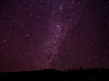 Milkyway galaxy and stars above the dark hill in Chiangmai, Thailand.