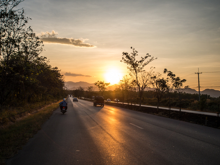 begin: Chiangmai, Thailand : Jan 15, 2017 : A moment of traveling with sun setting behind the hill. Editorial