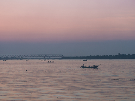 Beautiful moment of the people, sailors and the boats on the river of the evening sky.