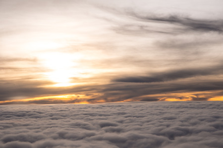 sunrises: The sky horizonntal line with the layers of cloud on the high altitude above the sea level. The sky of sun rises show the beautiful view of an orange color. Stock Photo