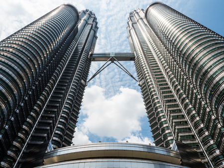 The upper view from the base of the Petronas Twin Towers, worlds landmark twin towers in Kaula Lumpur, Malaysia. Editorial
