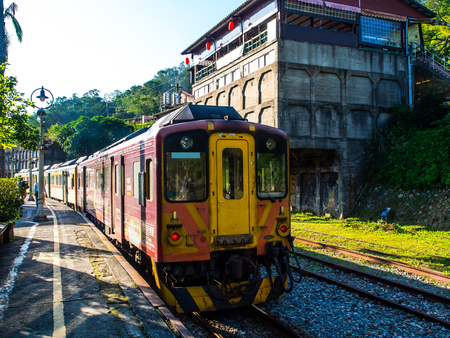 The old traditional train for sight seeing along the way toward Shifen waterfall, the largest waterfall in Taiwan. This train with sunlight and shade is really classic and nice to sit on. Editorial