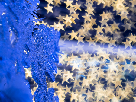 The selective focus of snowflake with the background of star shape bokeh along the wires of christmas decoration. Merry Christmas everyone. Foto de archivo