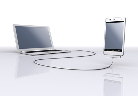 communicated: Laptop linked to smartphone Stock Photo