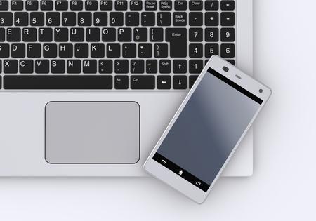 キーボードとスマート フォン 写真素材