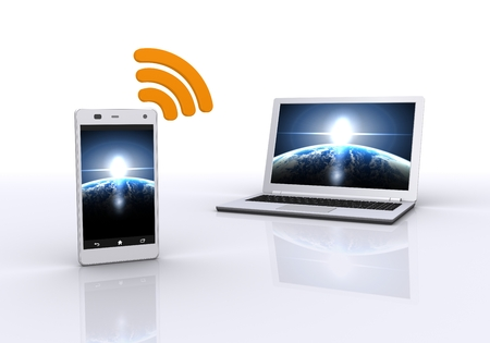 synchronous: Communication of smart phone and a laptop computer Stock Photo