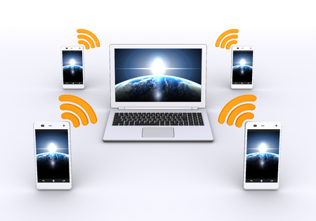 Communication of smart phone and a laptop computer Фото со стока