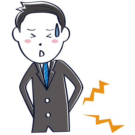 A businessman wearing a dark gray suit has low back pain