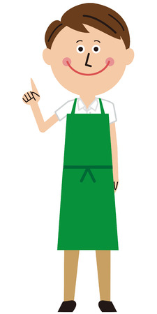 A man wearing a green apron points with a smile