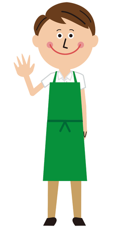 A man wearing a green apron greets